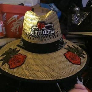 100 percent grass hat with chingona patch and two